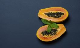 Papaya on bluish dark background with space for your text - image stock image