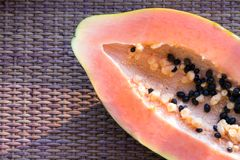 Papaya Carica papaya is an exotic, tasty, sweet fruit. Fruit of melon bread tree. Papaya seeds are edible and can be a cure. stock images