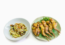 Papaya and crab spicy salad with blurred out grill chicken Royalty Free Stock Photo