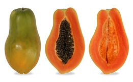 Papaya cut in the half of the cavity. Papaya is a kind of fruit. When ripe will be yellow to orange. Simply cut the papaya in the half of the cavity. The soft royalty free stock image