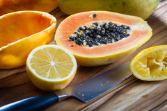 Papaya cut in half served with lemon Stock Images