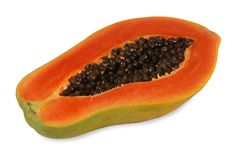 Papaya cut lenghways. Papaya is a kind of fruit. When ripe will be yellow to orange. Simply cut the papaya in the half of the cavity. The soft juicy, sweet stock photo
