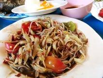 Papaya de Somtum yum en Tailandia Fotos de archivo