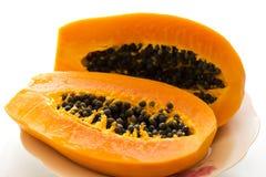 Papaya. A delicious ripe papaya on white background Stock Photography