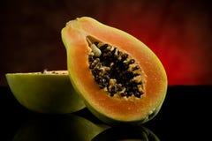 Papaya en el vector de cristal brillante Fotografía de archivo
