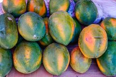 Papaya fresh fruits for sale at the street market royalty free stock photography