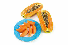 Papaya fruit in blue disc with white background Stock Photos