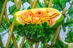 Papaya fruit carving. Stock Images