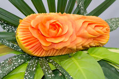 Papaya fruit carving in the form of roses. Stock Image
