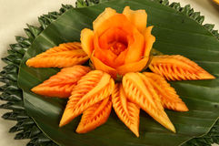 Papaya fruit  carving serve on banana leaf Royalty Free Stock Photos