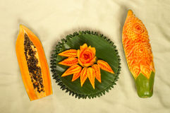 Papaya fruit  carving serve on banana leaf Royalty Free Stock Images