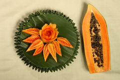 Papaya fruit  carving serve on banana leaf Stock Photography