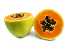 Papaya Fruit cut in half. Isolated on a white background Stock Images