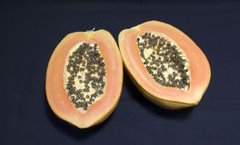 A papaya fruit cut in half Stock Image