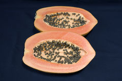 A papaya fruit cut in half Royalty Free Stock Image