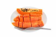 Papaya fruit in dish Isolated on white Royalty Free Stock Image
