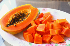 Papaya fruit half and cut pieces Stock Photos
