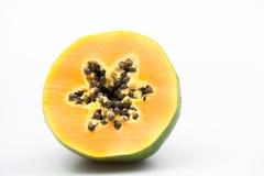 Papaya fruit - half and slice with seeds Stock Photo