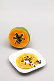 Papaya fruit - half and slice with seeds Stock Images