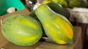 Papaya fruit in the market. Fruit healthy, Ripe papaya at market's.Papaya at fruits wholesale market place.Asian market stock video footage