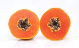 Papaya fruit sliced on half. On a white background Stock Photo