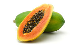 Papaya fruits. Half cut and whole papaya fruits on white background Stock Photo