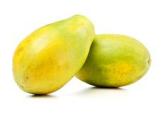 Papaya fruits. Two Papaya fruits on white background Royalty Free Stock Photo