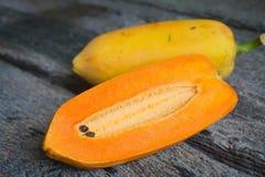 Papaya fruits. Papaya fruits are placed on the floor plates, old wood Stock Photos