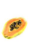 Papaya i vit bakgrund Fotografering för Bildbyråer