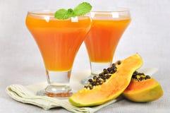 Papaya juice. Fresh blended papaya juice with a mint leaf Royalty Free Stock Image