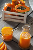 Papaya and kaky juice. In glass and bottle Stock Photos