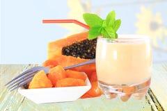Papaya milkshake with cut papaya Royalty Free Stock Photos