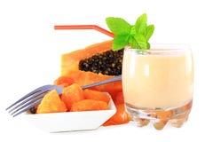 Papaya milkshake with cut papaya in pure white backgroundd Royalty Free Stock Images