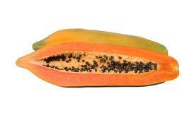 Papaya och frö för halva orange arkivfoto