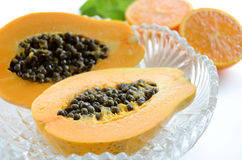 Papaya with orange and mint Royalty Free Stock Photography