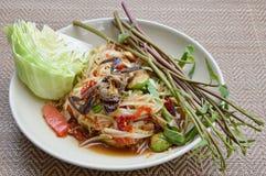 Papaya and pickled crab salad Thai food called Som Tum. Papaya and pickled crab salad on dish Thai food called Som Tum Royalty Free Stock Image