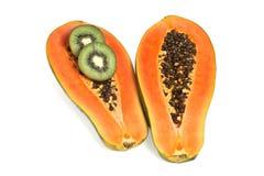 Papaya s half. Half cut papaya with two  kiwi slice on white background Royalty Free Stock Image