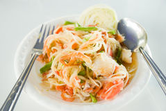 Papaya salad. With horse crab on the white foam dish Stock Photos