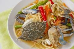 Papaya salad with blue crab. Thai popular dishes, spicy papaya salad with raw blue crab Royalty Free Stock Images