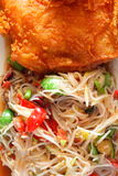 Papaya salad and  chicken fried.  Stock Images