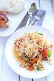 Papaya salad with Chicken grilled and sticky rice Stock Image