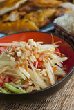 Papaya Salad with Chicken and Sticky Rice. Close up of papaya salad with grilled chicken and sticky rice royalty free stock image