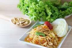 Papaya salad is delicious Thai food call Som Tum. In Thai served with vegetable Royalty Free Stock Images