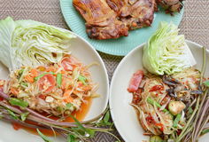 Papaya salad eat couple with grilled chicken Stock Photos
