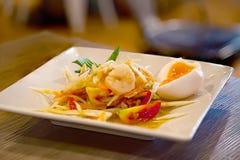 Papaya Salad, Famous Thai food, Somtum. Thai papaya salad with shrimp and egg royalty free stock images