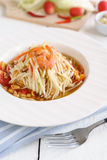 Papaya salad Famous Thai food. On white wooden table stock images