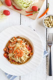 Papaya salad Famous Thai food on white wooden table. Top view Stock Photo