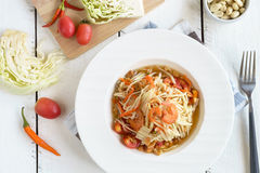 Papaya salad Famous Thai food on white wooden table. Top view stock photos