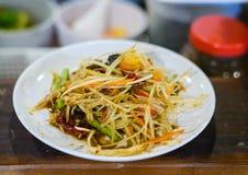 Papaya salad and fresh horse crab on white dish. Thai food Royalty Free Stock Photography