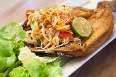 Papaya salad with fried fish Thai cuisine Stock Photos